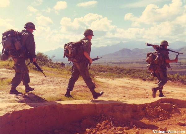 Soldiers from Co. 'D', 5th Bn., 46th Inf., 198th Inf. Bde. (Americal), move out from Landing Zone 'Bluff' at the start of a short range recon patrol.