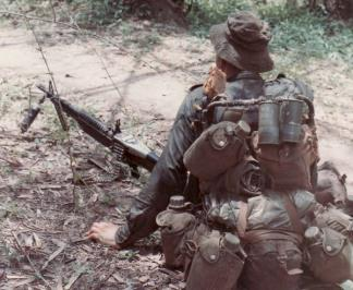 "A machine gunner of ""D"" Company, 5 RAR, lies waiting for the enemy during operation Mindy."