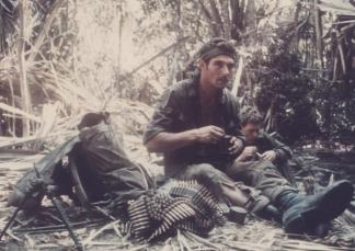 Private Richard Bradley, 'B' Squadron, 3rd Cavalry Regiment, 6 RAR, eats chow after sweeping a bunker complex south of Ap Rung La.