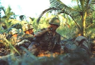 An officer of the 47th Infantry, 9th Infantry Division calls for support whilst pinned down by sniper fire near Ben Tre.