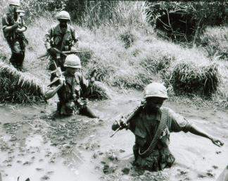 A squad of the 60th Infantry, 9th Infantry Division cross a stream during Operation Hot Tac.