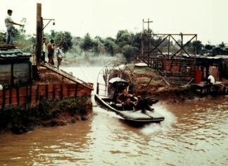 A Hurricane Aircat enters the docking facility at Camp Boyd in the Mekong Delta.
