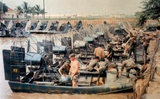 Members of  Special Forces Detachment A-404 (Company D) and the Vietnamese Mobile Strike Force prepare their airboats in the docking facility at Cau Lanh in the Mekong Delta.