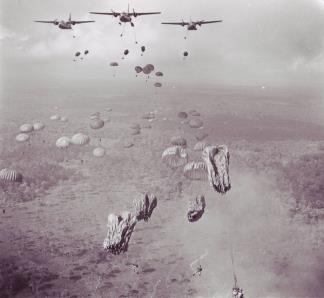 Vietnamese paratroopers jump from USAF C-123 transports during Operation Phi Hoa II, a tactical air-ground envelopment strike against Viet Cong in the Tay Ninh Province of South Vietnam.