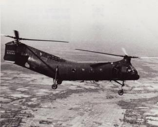 "A CH-21 Shawnee (""Flying Banana"") Helicopter from the 57th Helicopter Company flies over a Viet Cong area during a routine mission."