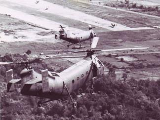 CH-21 helicopters returning to Soc Trang airfield after carrying ARVN troops on strikes against the Viet Cong.
