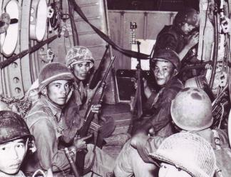 ARVN soldiers inside a CH-21 helicopter wait to be flown to the drop area.
