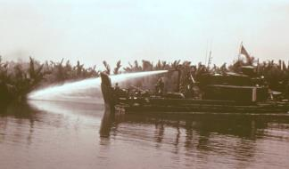 Douche boats, Armored Troop Carriers (ATC) converted to carry a water cannon, were capable of washing away the enemy riverbank mud bunkers, which would stand up to howitzer fire.