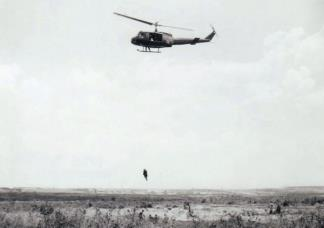 A Dustoff chopper extracts a wounded soldier as part of an exercise at the 199th Infantry Brigade training center near Bien Hoa (III Corps).