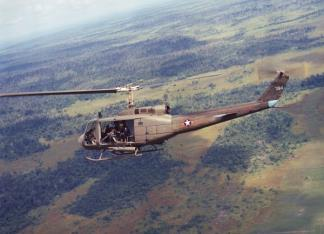 Vietnamese Air Force UH-1H helicopter in flight.