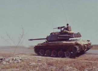 An M-41 Walker Bulldog tank from the 5th ARVN Cavalry opens fire on an enemy position in Bien Hoa (III Corps).