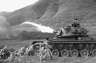 A Marine Corps M67 Flamethrower tank (M48 tank equipped with a flamethrower) in action in I Corps.