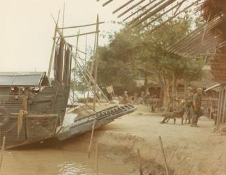 "A Navy Armored Troop Carrier (ATC) waits near Ben Tra to take Company ""A"", 4th Battalion, 47th Infantry, 9th Infantry Division to another location along the river."