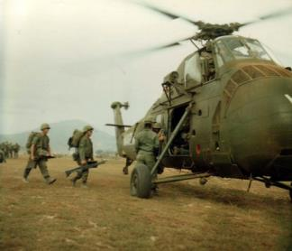 Members of the 1st Battalion 3rd Marines board a CH-34 Choctaw helicopter to be flown to position held by the 3rd Battalion 9th Marines.
