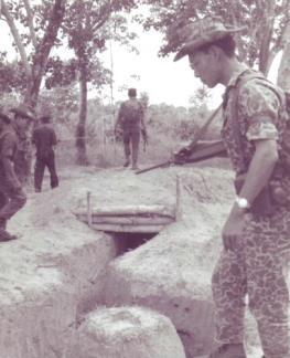 "Vietnamese Strike Forces discover a Viet Cong dugout in the Ap Suoi rubber plantation in war zone ""D"", north of Ben Cat (III Corps)."