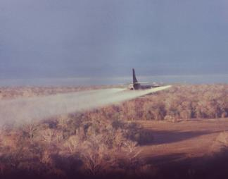 A C-123 sprays defoliant over the target area in South Vietnam during project Pink Rose.