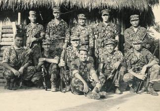 "Special Forces Detachment A-321, under Captain Edward Rybat (middle row, center), at their CIDG camp at Ben Cat in War Zone ""D"" (III Corps)."