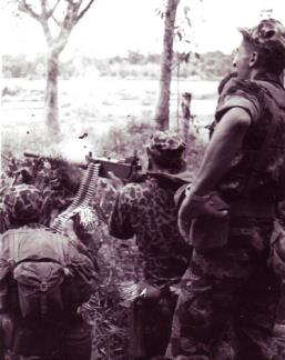 "A Special Forces machine gunner fires a Browning M1919 at a group of Viet Cong insurgents on the edge of the Ap Suoi Tre rubber plantation in war zone ""D"", north of Ben Cat (III Corps)."