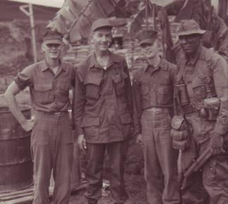 Three Marines from the 1st Reconnaissance Battalion spend time with Congressman Pettis of California during his visit to Vietnam.