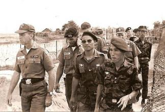 Captain William Bowser, commander of Special Forces detachment A-422, conducts a tour of the Vinh Gia camp for Brigadier General William DePuy (left), MACV J-3 (Director of Operations), Major Thuong, IV Corps Commander of Vietnamese Special Forces (LLDB), and LLDB Commander General Doan Van Quang (right).