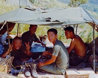 Troops of the 2nd Company, 1st Battalion, Cavalry Regiment, ROK Tiger Division, relax during Operation Surprise in the Central Highlands, 5 miles south of An Khe Pass.