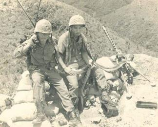 Private Shin (right) of the 10th Field Artillery Battalion, RoK Capital (Tiger) Division, takes a break from manning the machine gun post.