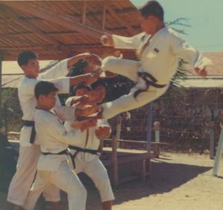 Sergeant  Lee Yong Bok executes a flying kick during a Tae Kwon Do demonstration held by the Korean Capital (Tiger) Division.