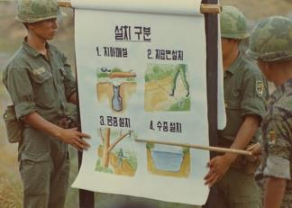 Soldiers of the 26th Regiment, ROK Tiger Division, give a presentation on the various types of booby-trap used by the Viet Cong.