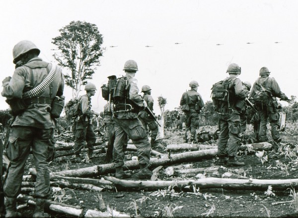 Soldiers of the 2nd Battalion, 503rd Infantry, 173rd Airborne await an airlift on operation Francis Marion.
