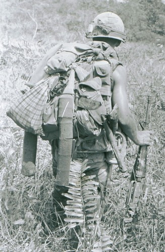 A soldier of the 5th Battalion, 46th Infantry, 198th Light Infantry Brigade uses a boot sock to carry his C-Ration cans whilst on an operation west of Chu Lai (I Corps).