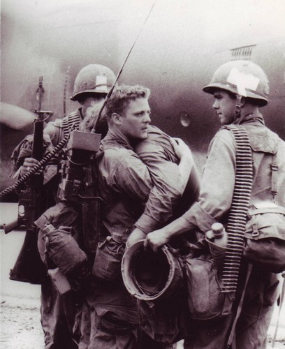 A Radioman comforts his friend who had just survived a battle during Operation Byrd in which nearly his entire platoon was wiped out.