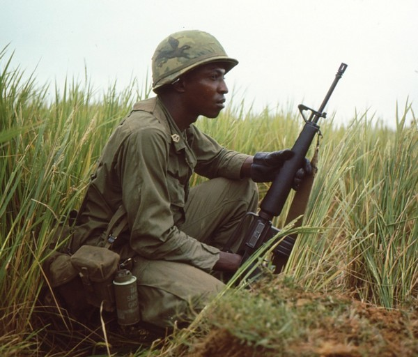 A Staff Sergeant of Company B, 1st Battalion, 505th Infantry, 82nd Airborne scans the terrain ahead whilst a on patrol in early 1968.
