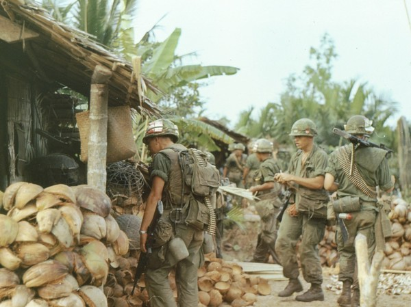Members of the 47th Infantry, 2d Brigade, 9th Infantry Division search a village near Ben Tre.