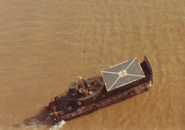 An aerial view of an Aid Boat- an Armored Troop Carrier (ATC) with a helicopter landing pad fitted over the foredeck.
