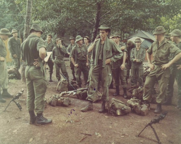 Members of the 5th Plt, Co 'B', 2nd Royal Australian Regiment, receive a briefing from the patrol leader.