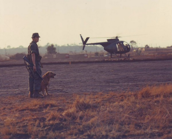 A dog handler with a combat tracker team from the 4th Inf.