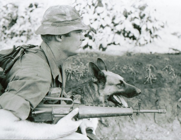 A Scout-Dog Handler with the 3rd Brigade, 4th Infantry Division wears a locally made camouflage boonie hat.