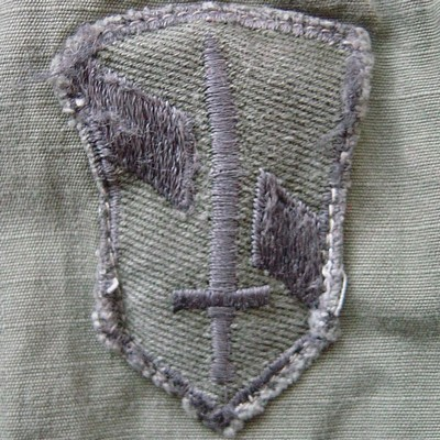 Locally made subdued I Field Force shoulder sleeve insignia.