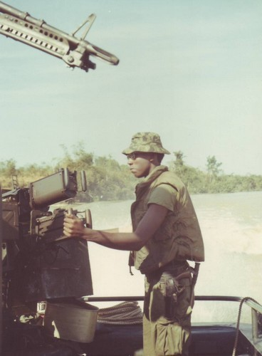 SKSN Ellis Manns of the 549th River Division stands by his 50 cal.