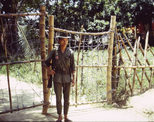 A young soldier from the South Vietnamese Popular Forces stands guard duty.