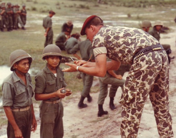 Vietnamese Rangers receive a course of instruction on demolitions from an advisor to the 77th Ranger Detachment.