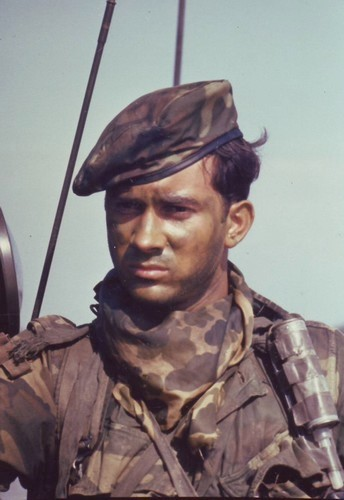 Hospital Corpsman 2nd Class Clarke Long wears camouflage grease paint during a SEAL Team One operation south of Saigon.