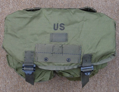 The top flap of the M-1967 USMC nylon combat field pack boasted a hanger for attaching an intrenching tool cover.