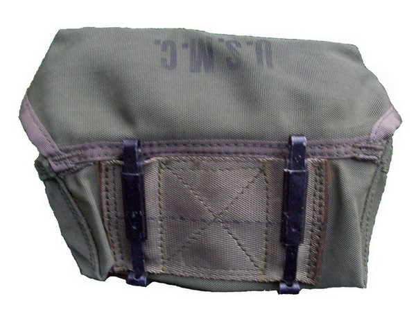 The slide keepers on the back of M-14H pouch were used to attach it to the equipment belt.