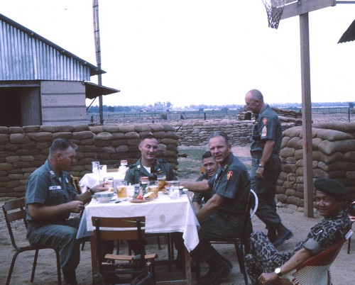 MACV advisors Croft, Houser, O'Neil, Barton and Fisher enjoy a break with ARVN officer Phoi, whilst at An Phu in the northern reaches of Mekong Delta.