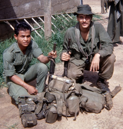 Spike Team Ohio medic Joe Parnar (right) and team grenadier Mock, a Rhade Montagnard, after returning from a mission.